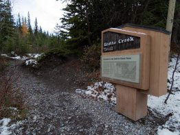 Trailhead on the west side of the parking lot.