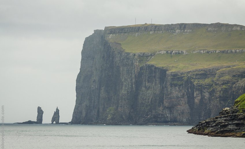 The sea stacks name Giant and his Wife are visible from Tjørnuvík