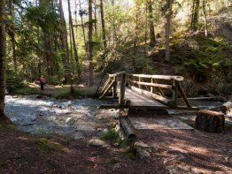 A sturdy wooden bridge takes you over Sinclair Creek